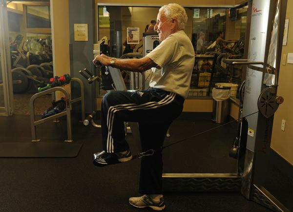 DENVER, CO - SEPTEMBER 13:   99-year-old Paul Marcus works out twice a week at the athletic club at the Jewish Community Center in Denver. He worked out his quads on Friday, September 13, 2013.    (Photo By Cyrus McCrimmon/The Denver Post )