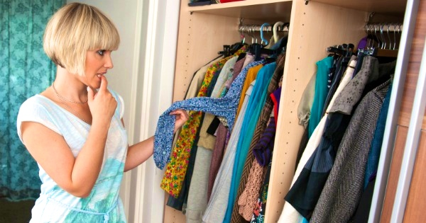 woman-looking-at-clothes-in-closet