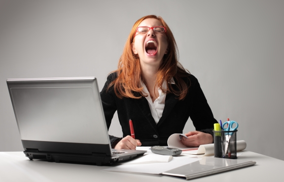 Stressed businesswoman screaming
